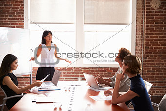 Group Of Businesswomen Meeting In Modern Boardroom