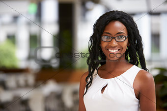 Portrait of young black businesswoman wearing glasses