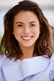 Smiling mixed race young businesswoman, vertical, close up