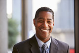 Middle aged black businessman smiling to camera