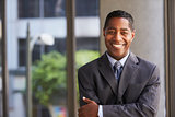 Middle aged black businessman looking at camera