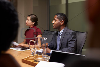 Business colleagues listening at boardroom meeting, close up