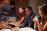 Business colleagues working together at a boardroom meeting