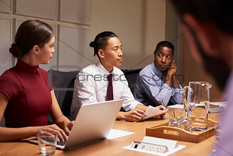 Corporate business colleagues at evening meeting, close up