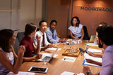 Business colleagues in discussion at a meeting in boardroom