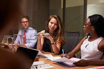 Business colleagues at a meeting in boardroom, close up