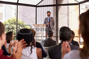 Audience applauding speaker at a business seminar