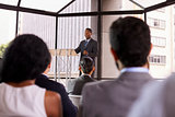 Black businessman presenting business seminar to an audience