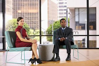 Smartly dressed man and woman on set for a TV interview