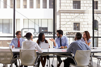 Corporate business team meeting in a modern open plan office