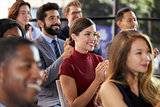Audience applauding at a business seminar, close up