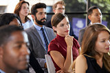 Audience at a business seminar listening to a speaker