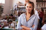 Smiling white female clothes designer in design studio
