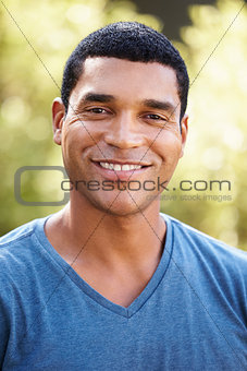 Portrait of smiling young African American man, vertical