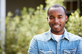 Happy young African American man in denim shirt, horizontal