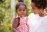 Portrait of African American mother holding baby daughter