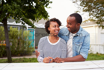 African American couple outside their new house