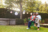 Senior African American couple sitting in their back garden