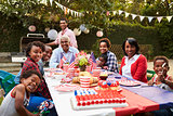 Multi generation black family having a 4th July garden party