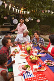 Multi generation black family at 4th July barbecue, vertical
