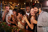 Friends celebrating together at a Christmas party in a bar