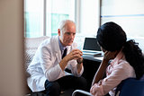 Doctor In Consultation With Depressed Female Patient