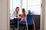 Pediatrician Talking To Child In Hospital