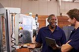 Engineer Training Male Apprentice On CNC Machine