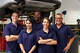 Portrait Of Auto Mechanics Working In Garage