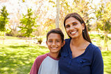 Mixed race Asian Caucasian mother and son in park, portrait