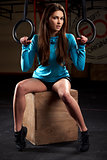 Portrait Of Young Woman In Gym With Olympic Rings