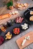 Bruschetta Ingredients for preparation near grill pan. Italian food. Antipasto.