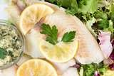 steamed tilapia fish with salad and tartar sauce