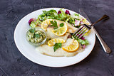 steamed tilapia fish with salad and tartar sauce with appliances