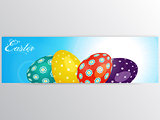 Easter banner with eggs over blue sky