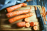 fresh long carrot on a chopping board