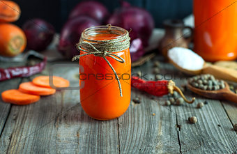 Fresh carrot juice in a glass jar