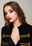 Beautiful fashion model wearing black gold jacket