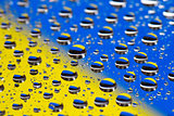the Abstract blue-yellow background of water drops on glass with reflectio, macro, concept flag color Ukraine in photo Maidan revolution