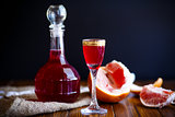 sweet grapefruit alcoholic cordial in the decanter with a glass