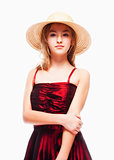 Girl in Red Dress and Stray Hat on her Head