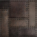 Dark rusty metal plates with rivets seamless background or texture