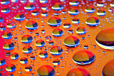 The Abstract orange red background with gradient color water drops on glass with reflection, bockeh, macro