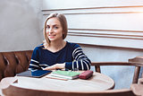 Woman smiling - portrait of happy lovely and beautiful woman in casual clothes indoor sitting in cafe