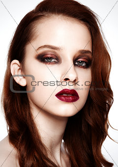 Beauty fashion model ginger hair and red makeup