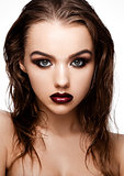 Beauty smokey eyes red lips makeup wet hair model