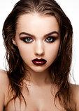 Beauty smokey eyes red lips makeup wet hair model