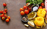 Italian food ingredients - vegetables, olive oil, spices and parmesan cheese