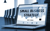 Small Business Strategy - on Laptop Screen. Closeup. 3D.