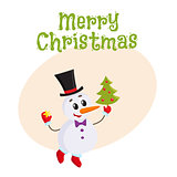 Cute and funny little snowman decorating a Christmas tree